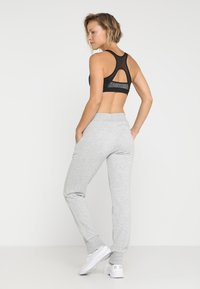Puma - ESS PANTS - Tracksuit bottoms - light gray heather - 2
