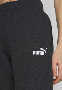 Puma - ESS PANTS - Tracksuit bottoms - dark grey heather - 4