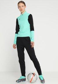 Puma - TRAINING PANT - Pantalon de survêtement - biscay green/black - 1