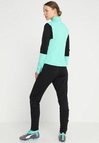 Puma - TRAINING PANT - Pantalon de survêtement - biscay green/black - 2
