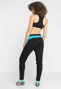 Puma - TRAINING PANT - Pantaloni sportivi - black/caribbean sea - 2