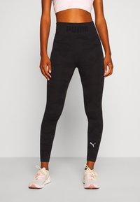 Puma - EVOKNIT SEAMLESS LEGGINGS - Leggings - black - 0
