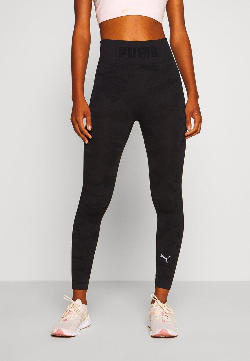 Puma - EVOKNIT SEAMLESS LEGGINGS - Leggings - black
