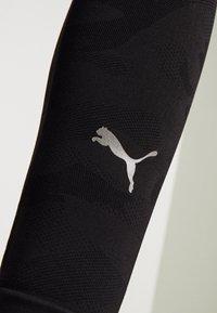 Puma - EVOKNIT SEAMLESS LEGGINGS - Leggings - black - 5