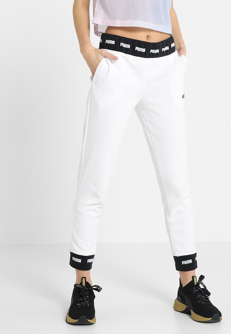 Puma - AMPLIFIED PANTS - Træningsbukser - white