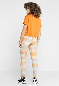 Puma - LEGGINGS - Tights - orange - 2