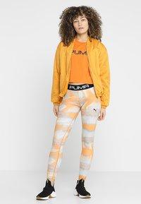 Puma - LEGGINGS - Tights - orange - 1