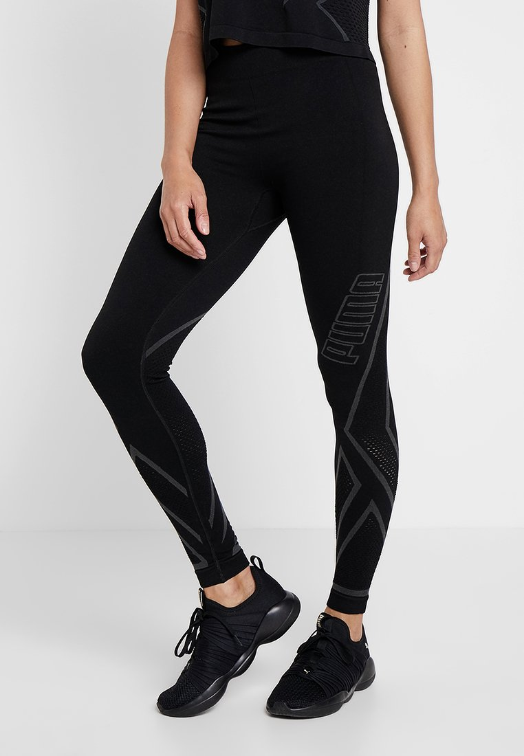 Puma - SEAMLESS LEGGINGS - Tights - black