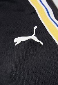 Puma - TRACK PANTS - Jogginghose - black - 5