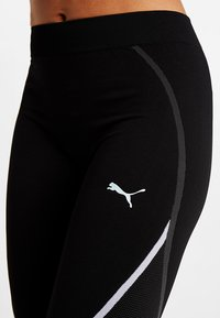 Puma - SEAMLESS LEGGINGS - Legginsy - black - 5