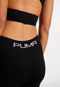 Puma - SEAMLESS LEGGINGS - Tights - black - 3