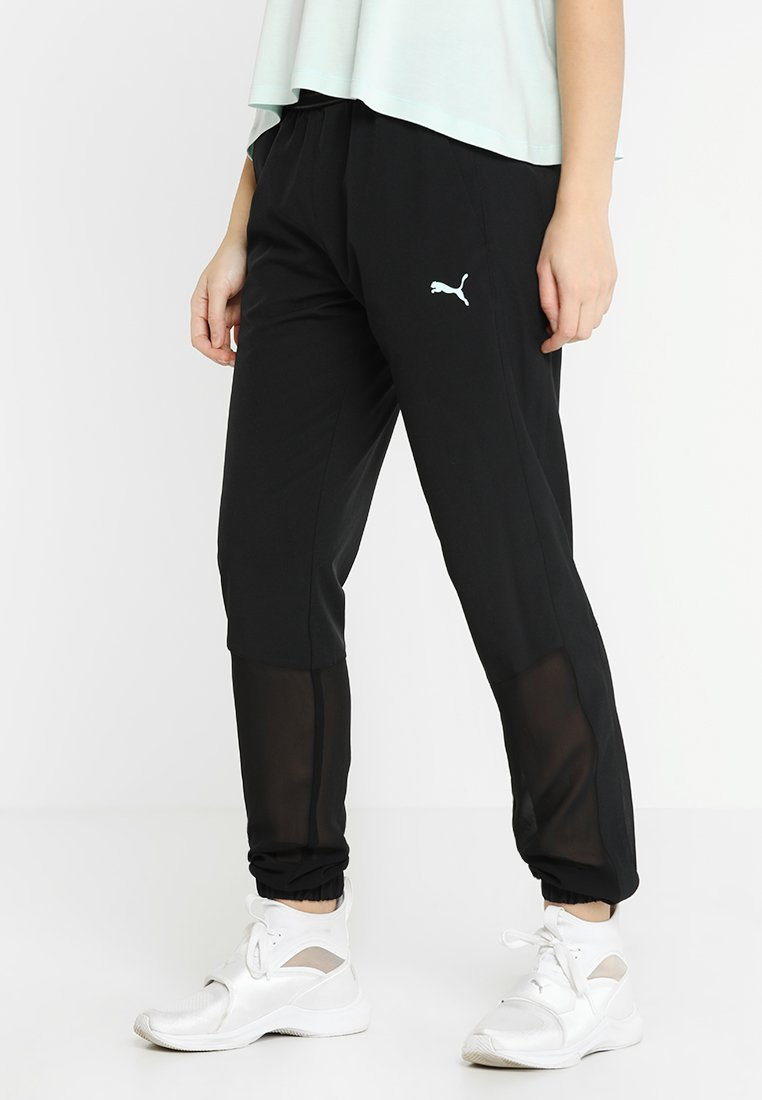 Puma - PANTS - Tracksuit bottoms - black