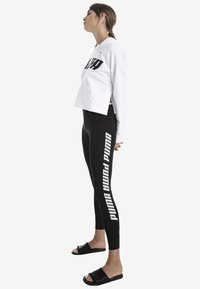 Puma - FOLDUP - Leggings - black - 1