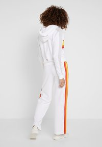 Puma - PERFORMANCE PANTS - Tracksuit bottoms - white - 2