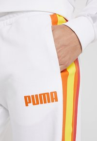 Puma - PERFORMANCE PANTS - Tracksuit bottoms - white - 4