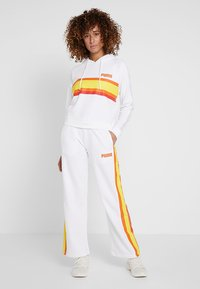 Puma - PERFORMANCE PANTS - Tracksuit bottoms - white - 1