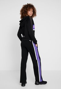 Puma - PERFORMANCE PANTS - Pantaloni sportivi - black - 2
