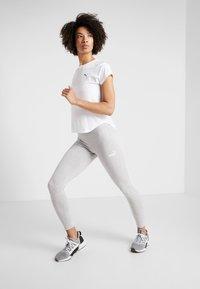 Puma - AMPLIFIED LEGGINGS - Collants - light gray heather - 1