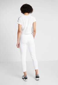 Puma - AMPLIFIED PANTS - Spodnie treningowe - puma white - 2