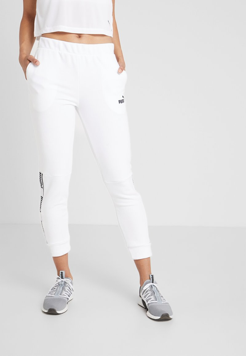 Puma - AMPLIFIED PANTS - Spodnie treningowe - puma white