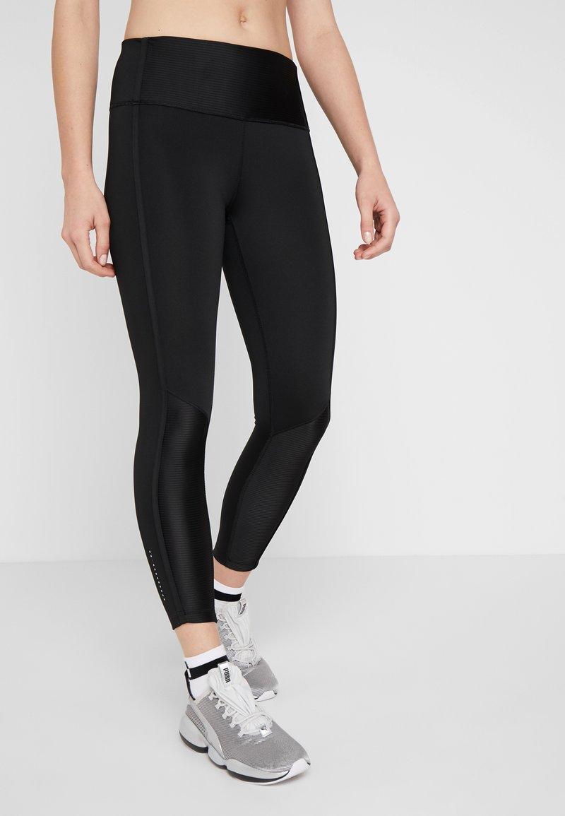 Puma - EVOSTRIPE LEGGINGS - Tights - black