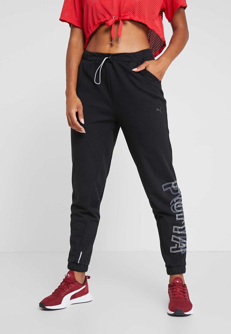 Puma - HIT FEEL IT PANT - Pantalones deportivos - puma black