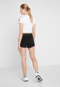 Puma - LOGO SHORT - Sports shorts - puma black/white - 2