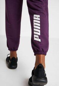 Puma - MODERN SPORT TRACK PANTS - Pantaloni sportivi - plum purple - 3