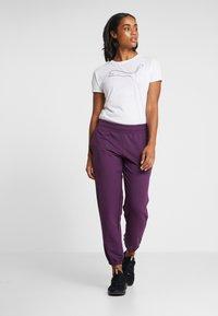 Puma - MODERN SPORT TRACK PANTS - Pantaloni sportivi - plum purple - 1