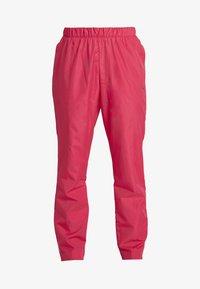 Puma - WARM UP PANT - Teplákové kalhoty - rose - 3