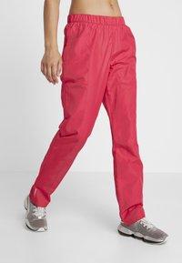 Puma - WARM UP PANT - Teplákové kalhoty - rose - 0
