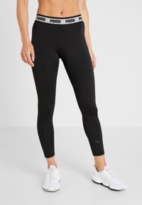 Puma - SOFT SPORTS LEGGINGS - Tights - puma black - 0