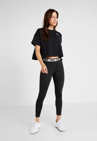 Puma - SOFT SPORTS LEGGINGS - Tights - puma black - 1