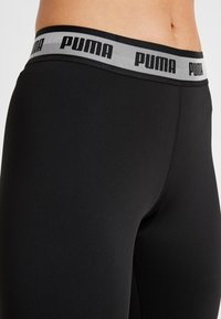 Puma - SOFT SPORTS LEGGINGS - Tights - puma black