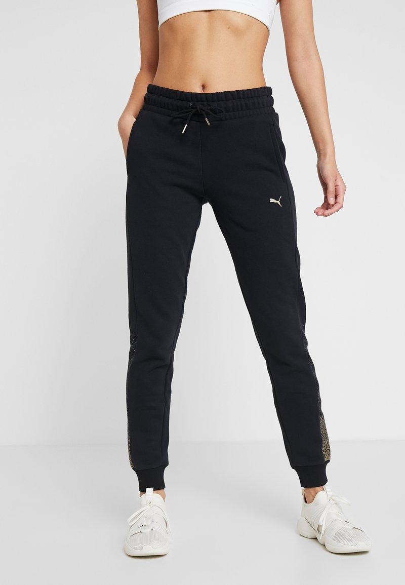Puma - HOLIDAY PACK PANTS  - Verryttelyhousut - cotton black