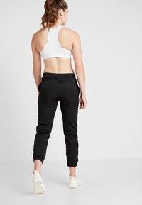 Puma - ACTIVE PANTS - Teplákové kalhoty - puma black - 2