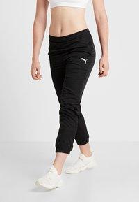Puma - ACTIVE PANTS - Teplákové kalhoty - puma black - 0