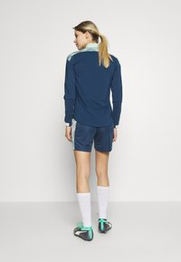 Puma - FTBLNXT SHORTS - Sports shorts - dark denim/mist green - 2