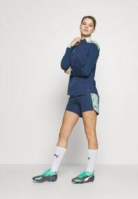 Puma - FTBLNXT SHORTS - Sports shorts - dark denim/mist green - 1