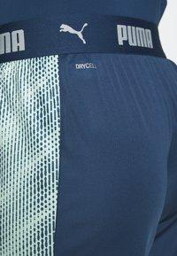 Puma - FTBLNXT SHORTS - Sports shorts - dark denim/mist green - 5