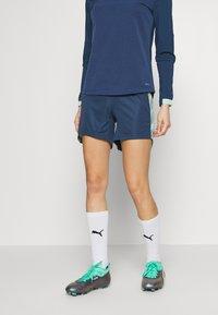 Puma - FTBLNXT SHORTS - Sports shorts - dark denim/mist green - 0