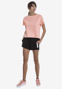 Puma - Sports shorts - black - 1