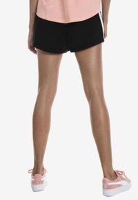 Puma - Sports shorts - black - 2