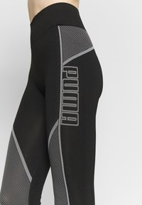 Puma - EVOSTRIPE EVOKNIT LEGGINGS - Legging - black - 4