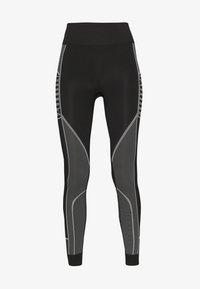 Puma - EVOSTRIPE EVOKNIT LEGGINGS - Legging - black - 3