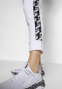 Puma - AMPLIFIED PANTS  - Tracksuit bottoms - puma white - 3