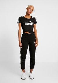 Puma - AMPLIFIED PANTS  - Trainingsbroek - black - 1