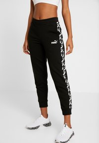 Puma - AMPLIFIED PANTS  - Trainingsbroek - black - 0
