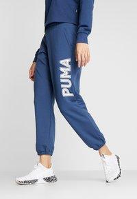 Puma - MODERN SPORTS PANTS - Tracksuit bottoms - dark denim - 0