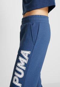 Puma - MODERN SPORTS PANTS - Tracksuit bottoms - dark denim - 3